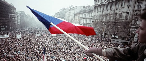 A young man holds Czechoslovak flag at the Wenceslas Square where gathered thousands of people in November 1989.